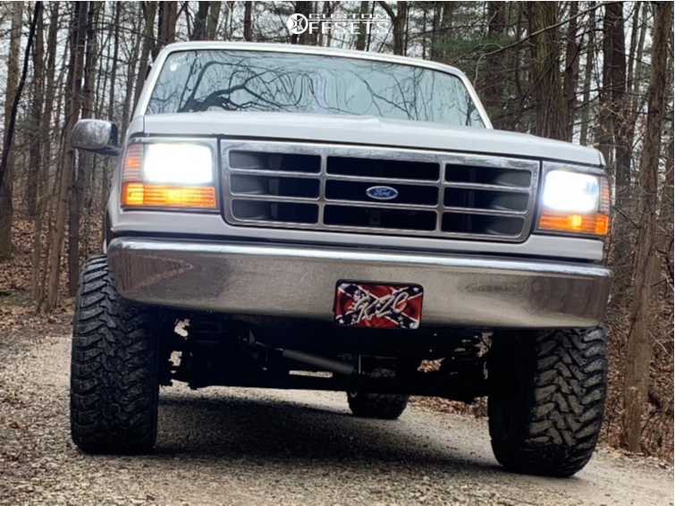 "1995 Ford F-150 Aggressive > 1"" outside fender on 20x12 -55 offset Vision Sliver and 33""x12.5"" Toyo Tires Open Country M/t on Suspension Lift 4"" - Custom Offsets Gallery"