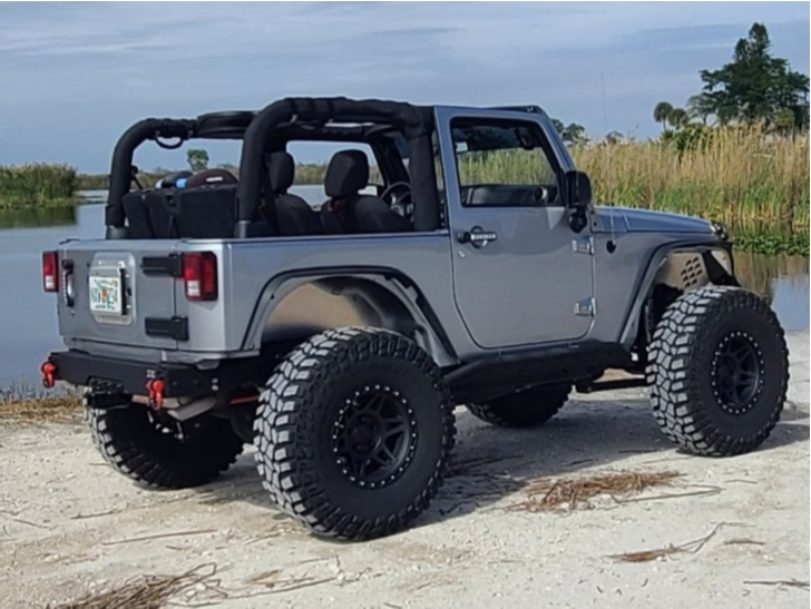"2018 Jeep Wrangler Aggressive > 1"" outside fender on 17x9 -12 offset Method MR312 and 37""x12.5"" Cooper Discoverer STT Pro on Suspension Lift 3.5"" - Custom Offsets Gallery"
