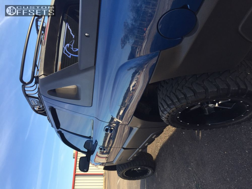"""2003 Chevrolet Avalanche Super Aggressive 3""""-5"""" on 20x10 -19 offset Hostile Switch Blade and 33""""x12.5"""" Toyo Tires Open Country M/T on Leveling Kit & Body Lift - Custom Offsets Gallery"""