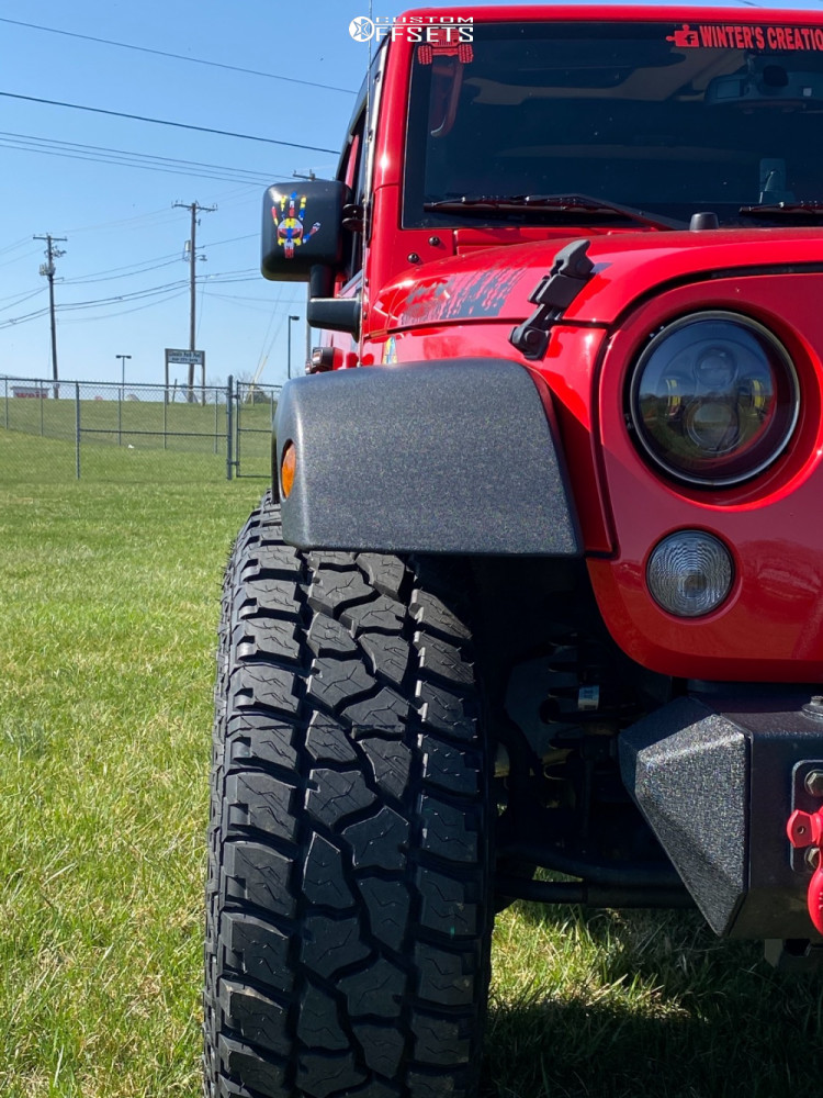 "2017 Jeep Wrangler JK Aggressive > 1"" outside fender on 17x9 -12 offset Method Mr312 and 295/70 Mickey Thompson Atz P3 on Stock Suspension - Custom Offsets Gallery"