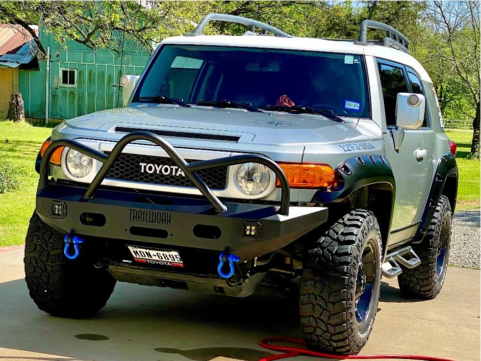 "2012 Toyota FJ Cruiser Aggressive > 1"" outside fender on 17x9 18 offset Mayhem Fierce and 285/70 Cooper Discoverer Stt Pro on Stock Suspension - Custom Offsets Gallery"