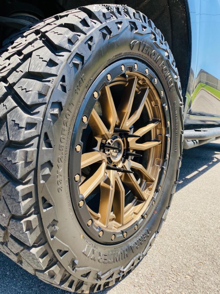 "2020 Chevrolet Silverado 1500 Aggressive > 1"" outside fender on 20x10 -11 offset Fuel Rebel and 33""x12.5"" Venom Power Terra Hunter X/t on Leveling Kit - Custom Offsets Gallery"
