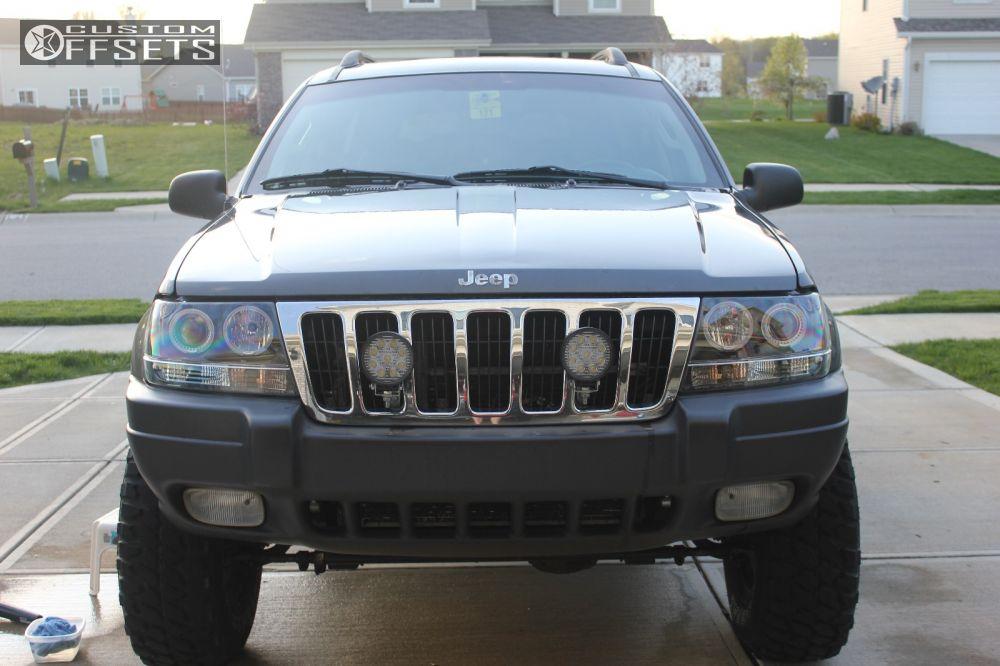 3 2003 Grand Cherokee Jeep Suspension Lift 4 Pro Comp 52 Black Aggressive 1 Outside Fender