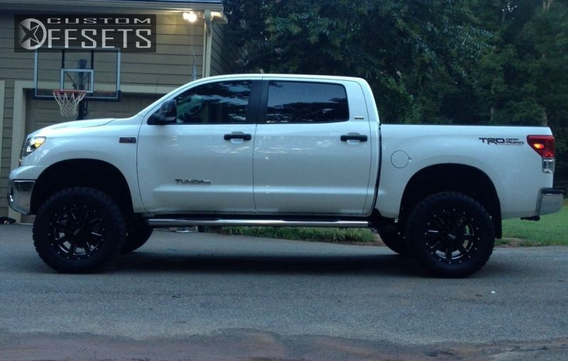 2252 3 2012 tundra toyota suspension lift 6 moto metal mo962 black aggressive 1 outside fender.jpg