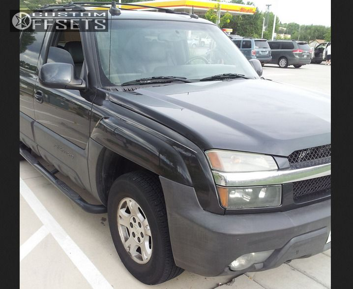 2003 Chevrolet Avalanche Tucked on 16.5x7 31 offset Stock OEM and 265/70 Goodyear Stock on Stock - Custom Offsets Gallery