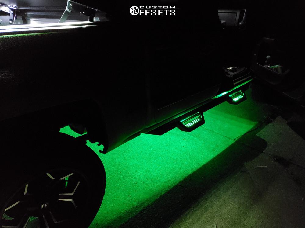 "2015 Chevrolet Silverado 1500 Aggressive > 1"" outside fender on 20x10 -18 offset Fuel D606 and 305/55 BFGoodrich All Terrain Ta Ko2 on Leveling Kit - Custom Offsets Gallery"