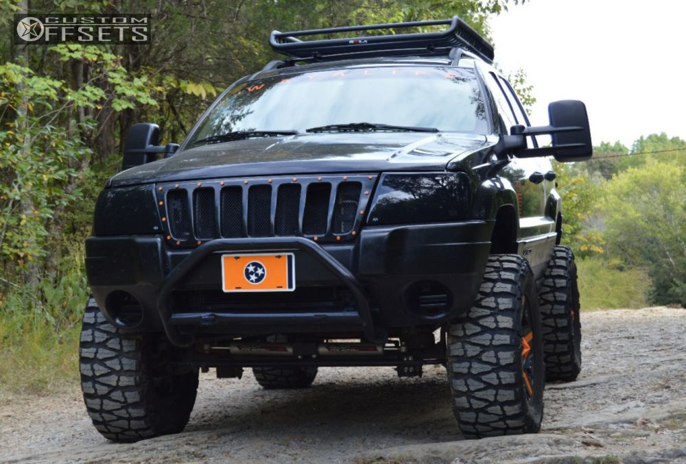 ... 1 2004 Grand Cherokee Jeep Suspension Lift 6 Kmc Rockstars Black  Aggressive 1 Outside Fender ...